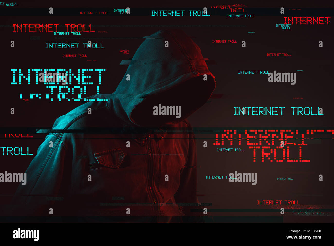 Internet troll concept with faceless hooded male person, low key red and blue lit image and digital glitch effect - Stock Image