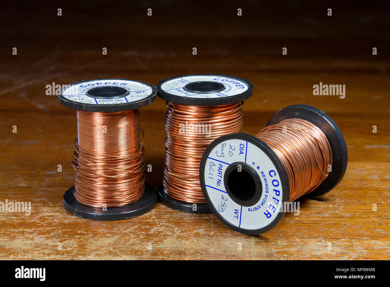 Coils of copper wire as used in a UK secondary/high school. - Stock Image