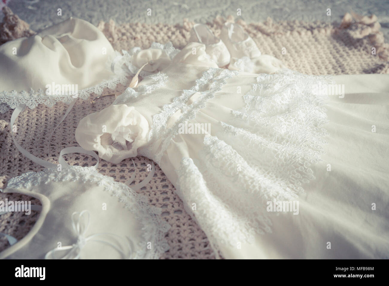 Baby girl's white lace fancy dress and accessories for Baptism christening - Stock Image