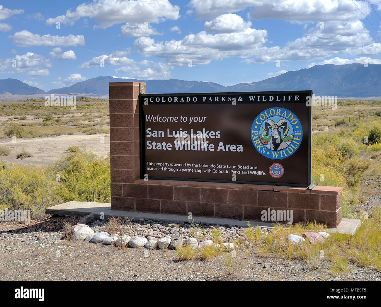 San Luis Lakes State Wildlife Area overlooks the Great Sand Dunes National Park.  The park is home to enormous sand dunes up to 700 feet high, an unus - Stock Image