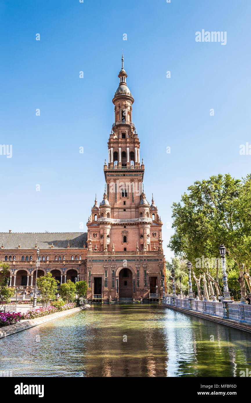 Tower and river of the Central building at the Plaza de Espana in Seville, Andalusia, Spain. It's example of the Renaissance Revival style in Spanish  - Stock Image