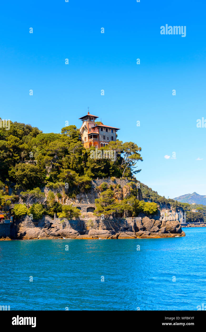 Sea way to Portofino, is an Italian fishing village, Genoa province, Italy. A vacation resort with a picturesque harbour and with celebrity and artist - Stock Image