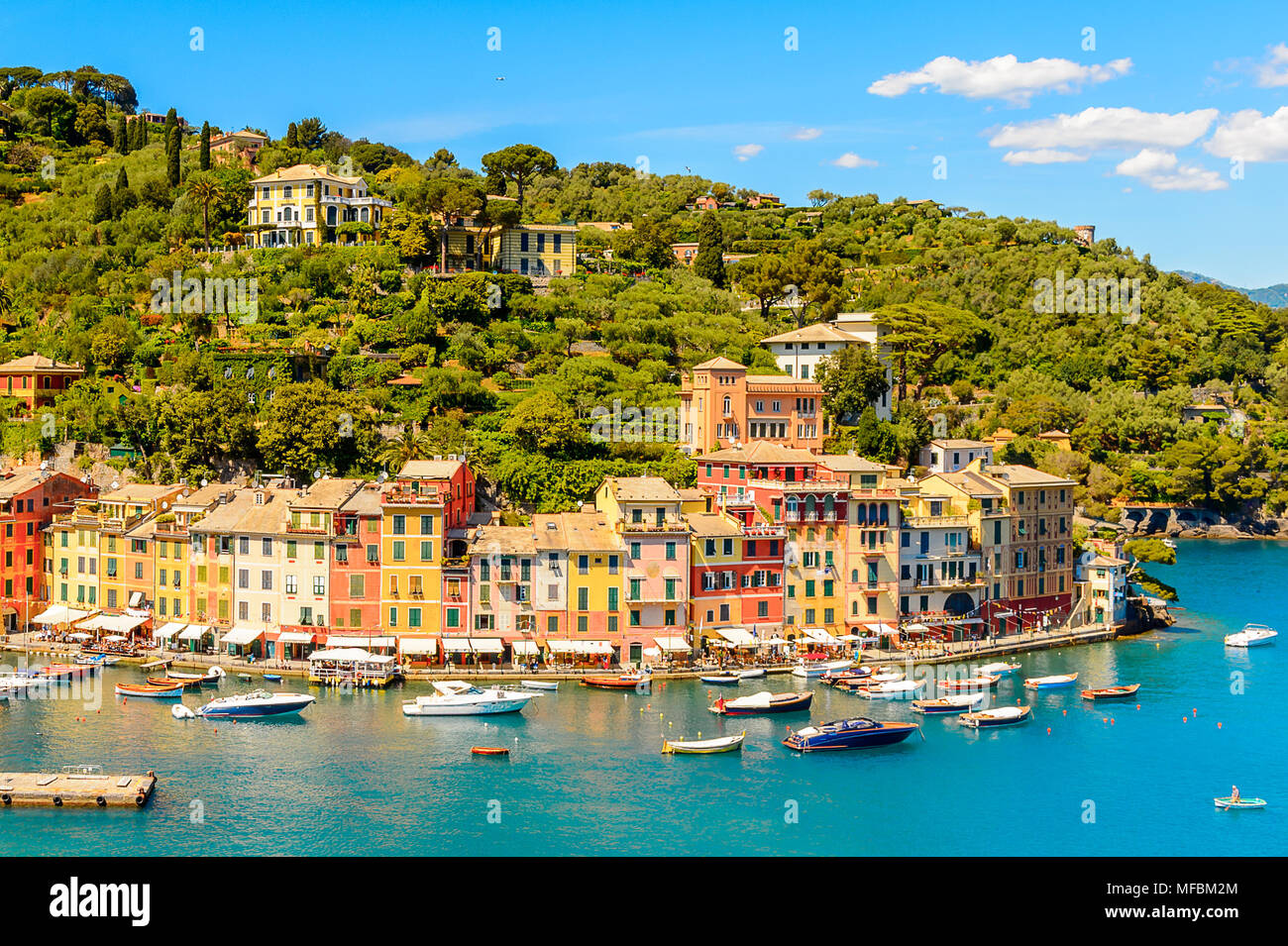 Panoramiv view of Portofino, is an Italian fishing village, Genoa province, Italy. A vacation resort with a picturesque harbour and with celebrity and - Stock Image