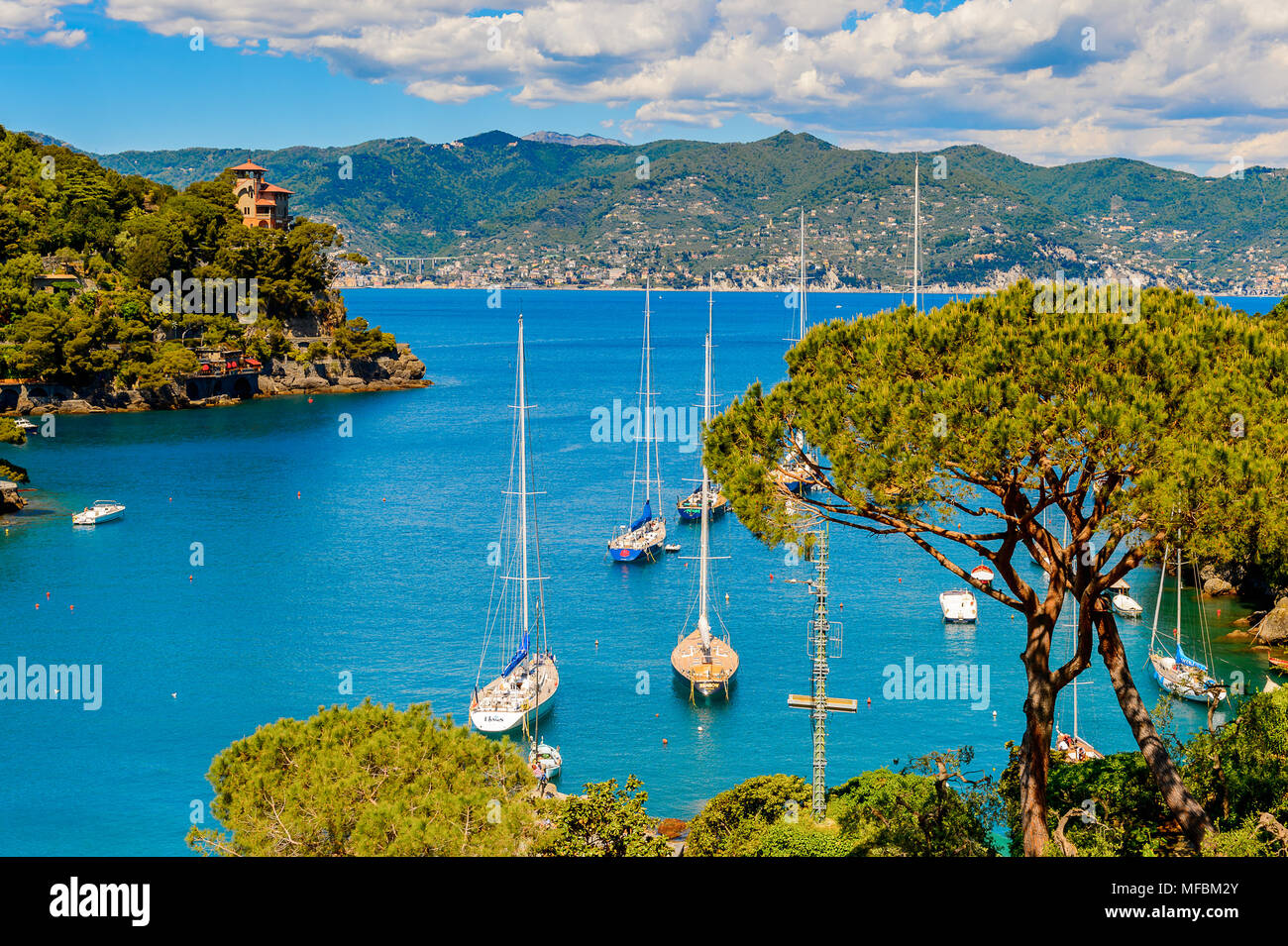Harbour of Portofino, is an Italian fishing village, Genoa province, Italy. A vacation resort with a picturesque harbour and with celebrity and artist - Stock Image
