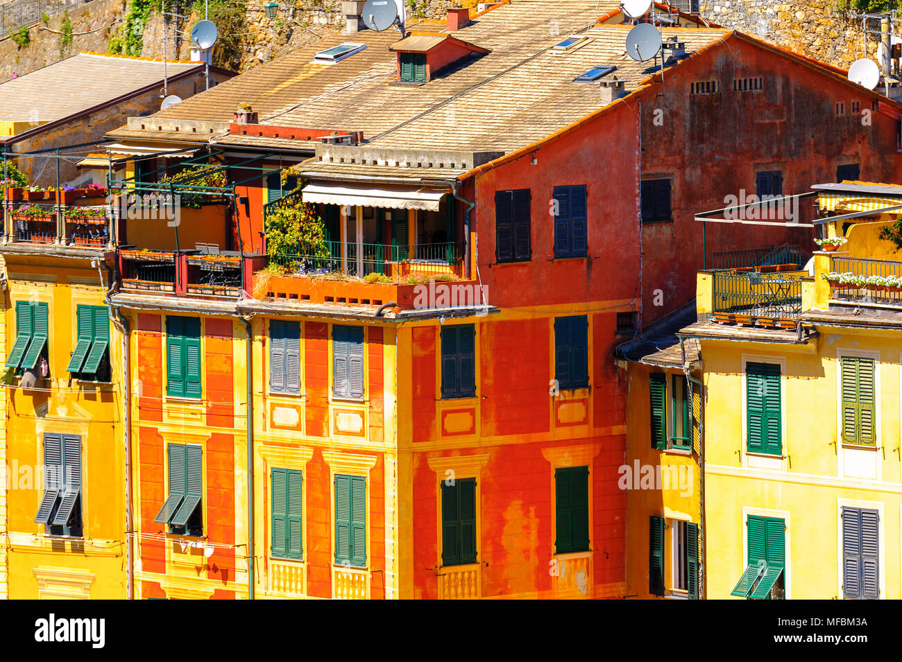 Close view of the colorful houses in Portofino, an Italian fishing village, Genoa province, Italy. A vacation resort with a picturesque harbour and wi - Stock Image
