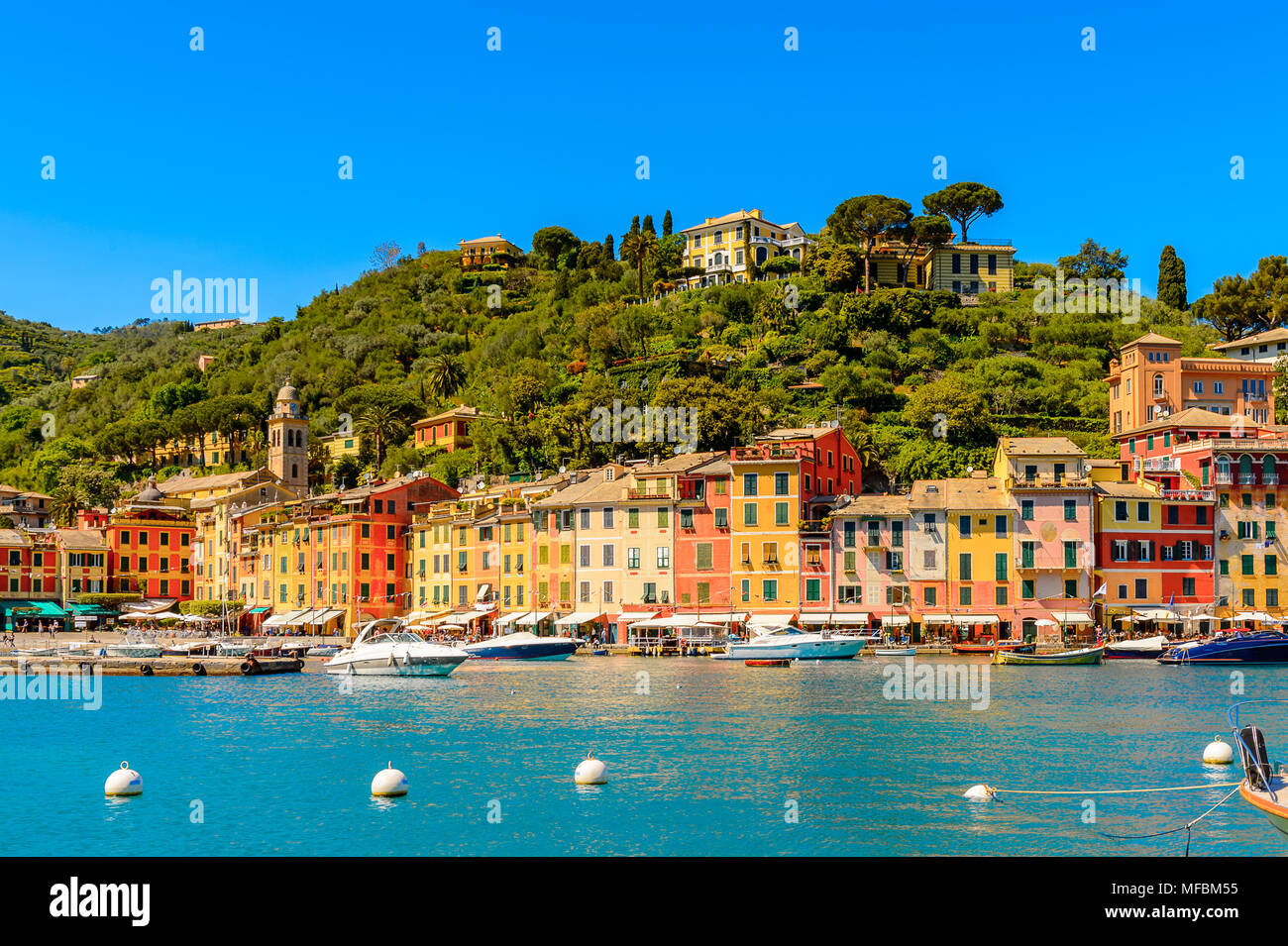 Portofino, is an Italian fishing village, Genoa province, Italy. A vacation resort with a picturesque harbour and with celebrity and artistic visitors - Stock Image