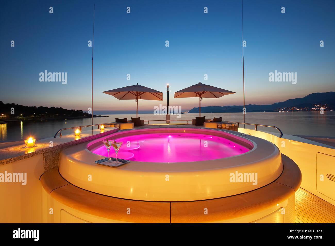 Superyacht jacuzzi at sunset - Stock Image