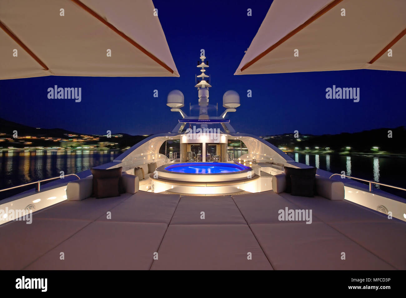 Superyacht sundeck with jacuzzi at night - Stock Image