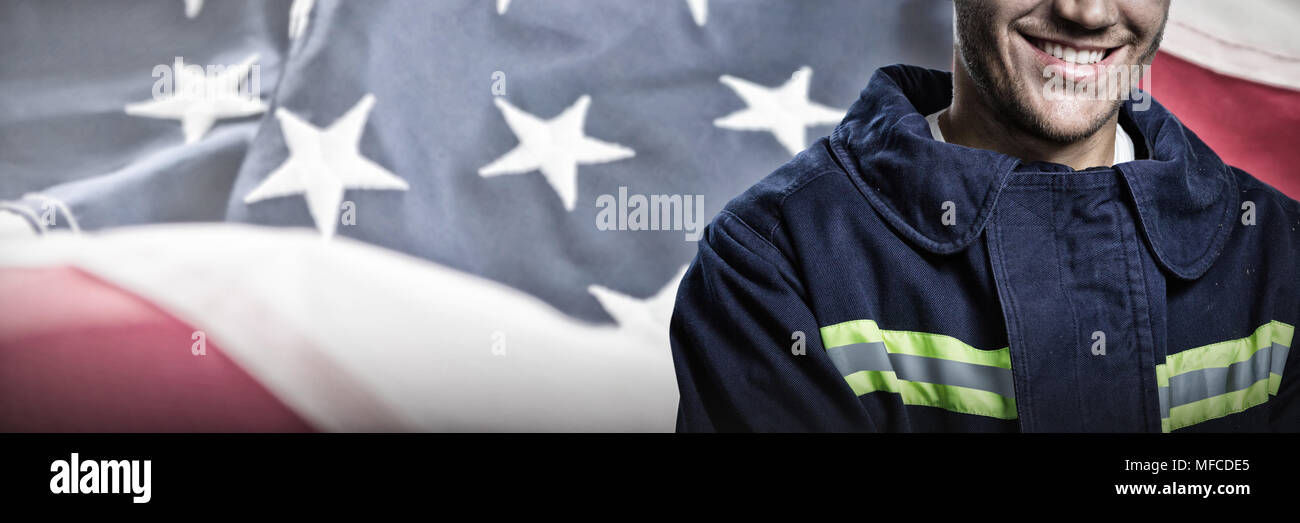 Composite image of smiling firefighter - Stock Image