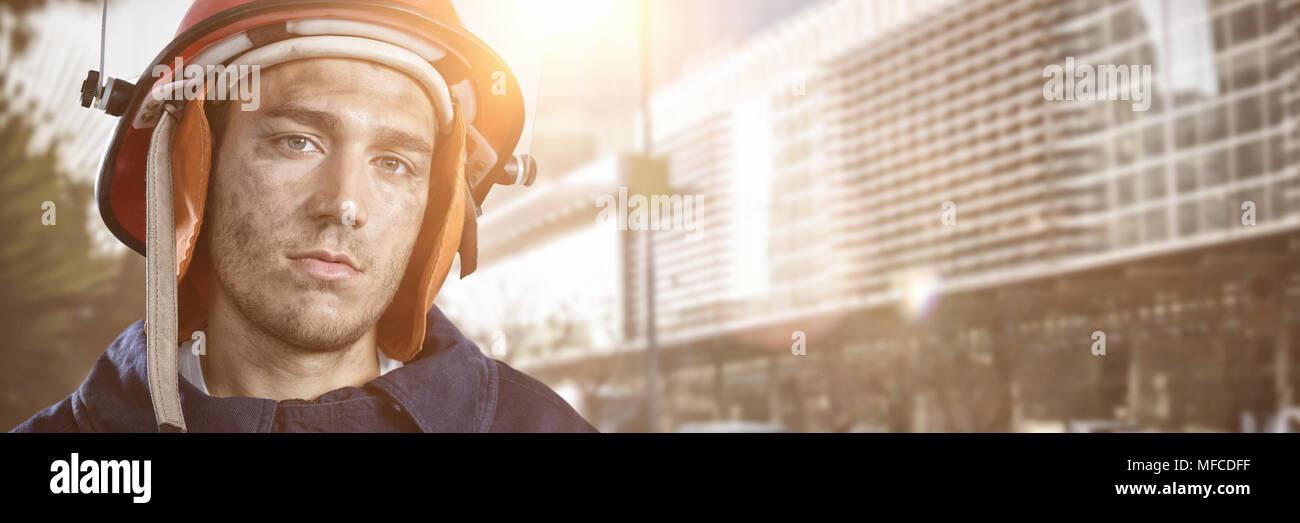Composite image of serious fireman Stock Photo