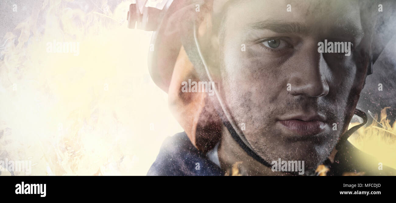 Composite image of serious fireman - Stock Image