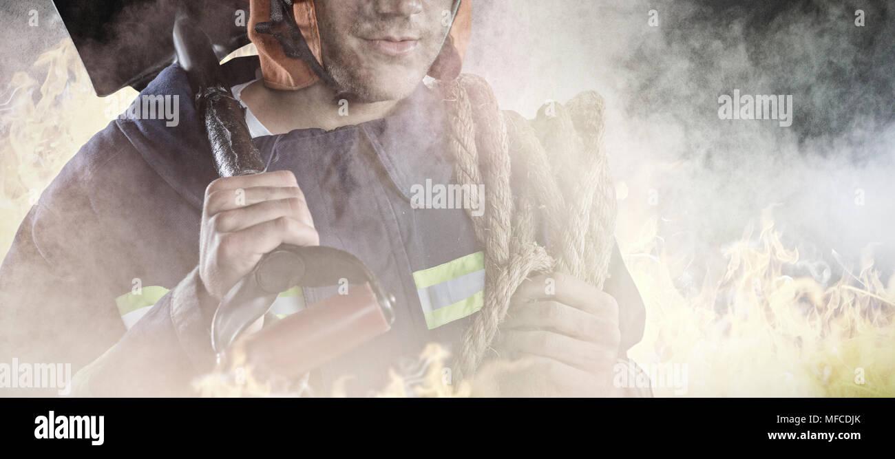 Composite image of professional fireman - Stock Image