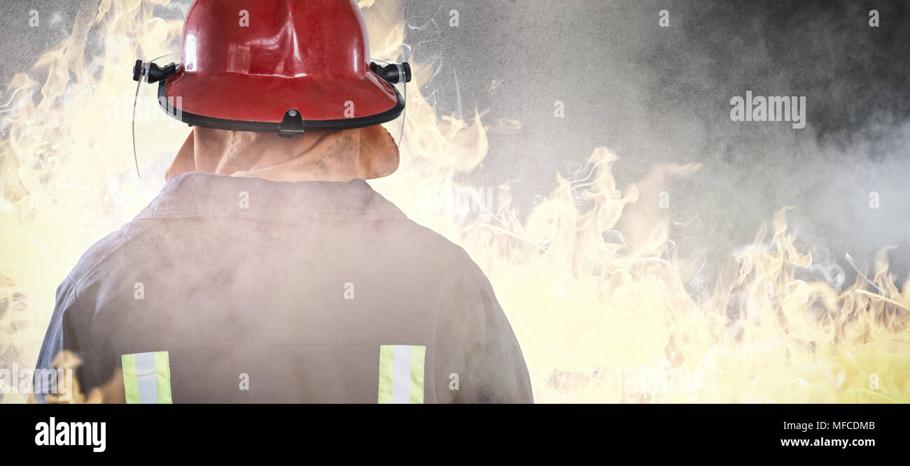 Composite image of back of firefighter - Stock Image