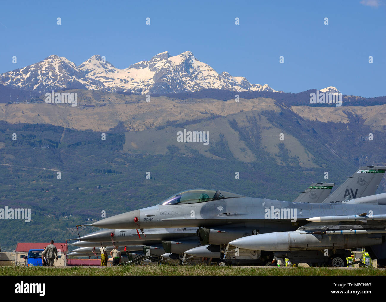 F-16 Fighting Falcons sit on the flightline at Aviano Air Base, Italy, April 19, 2018. Airmen from the 555th Aircraft Maintenance Unit perform routine maintenance on the jets before they fly. - Stock Image