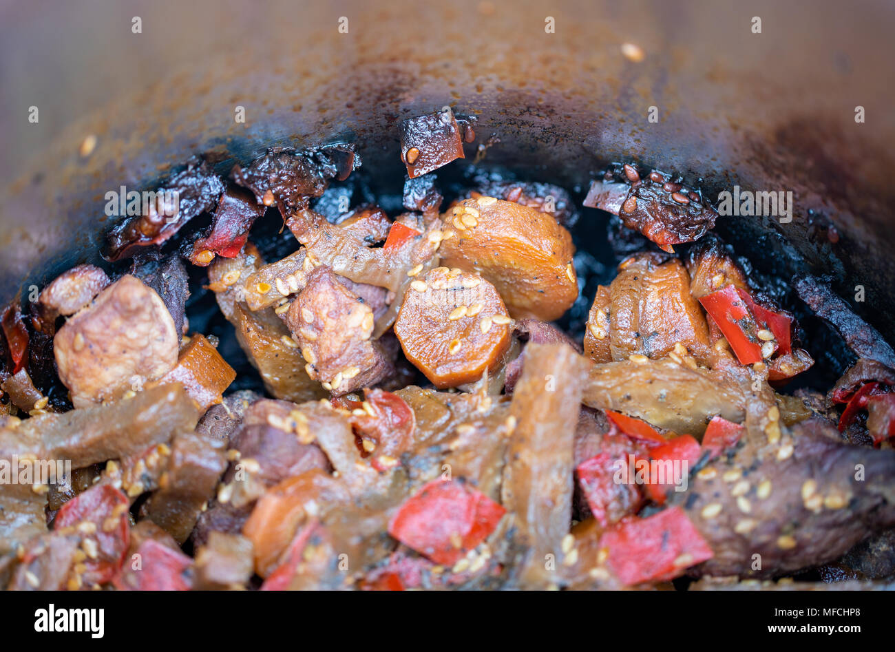 Burned dish in a pot. Unattended meal left on fire. Damage and loss - inattention. - Stock Image