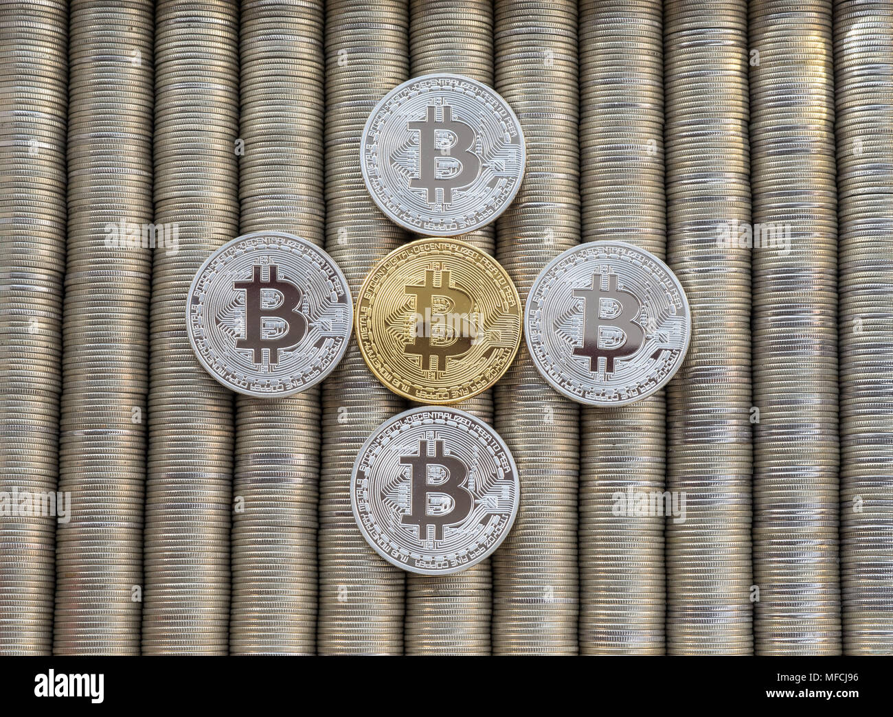 Silver Gold Crypto coins bitcoin BTC. Metal coins are laid out in a smooth background to each other, close-up view from the top, crypto currency excha - Stock Image