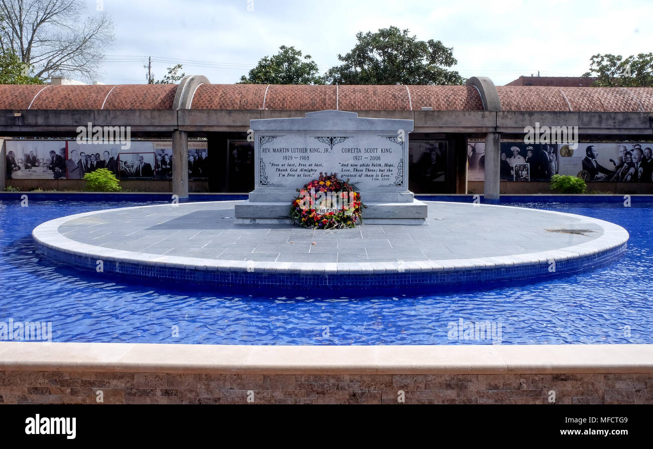 The tomb of Martin luther King and his wife Corretta Scott King there is writing on the tomb with a reath infront, the tomb is on a raised circular co - Stock Image