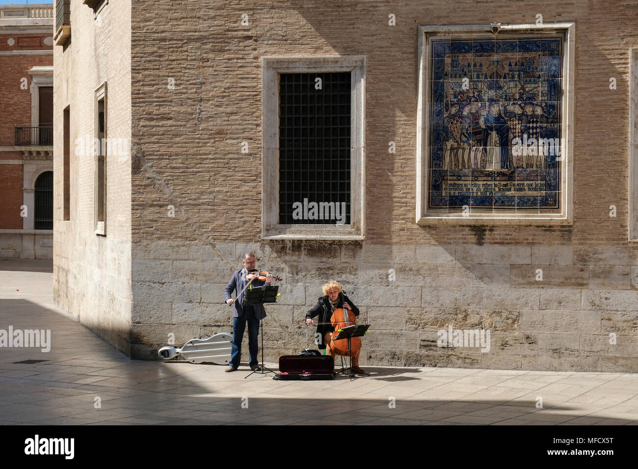 Street performers playing music in Plaza Decimo Junio Bruto, part of the old historical centre, North Ciutat Vella district, Valencia, Spain. Stock Photo