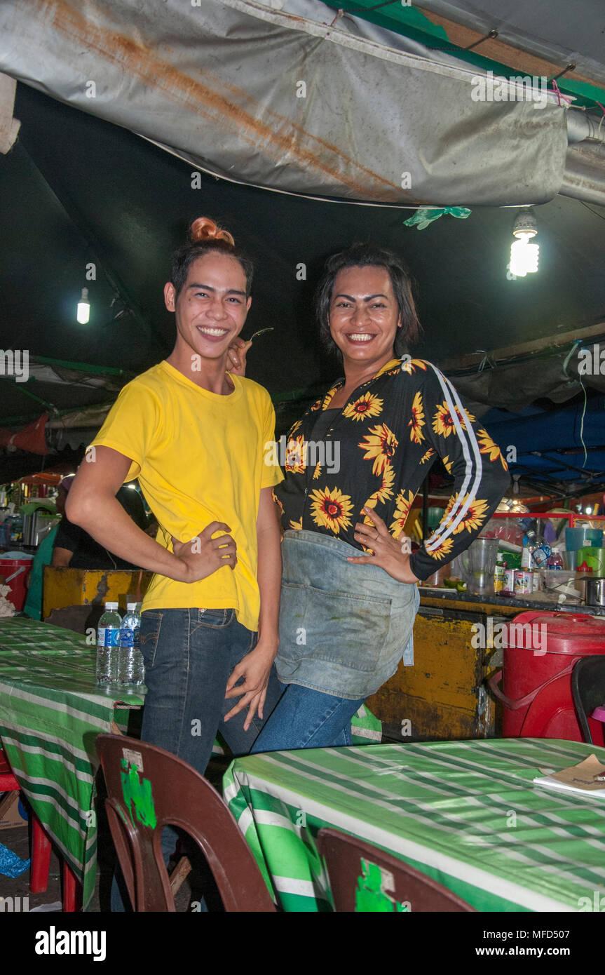 Two stallholders, overtly transgender, at the night market on the waterfront at Kota Kinabalu, Sabah, Malaysian Borneo - Stock Image