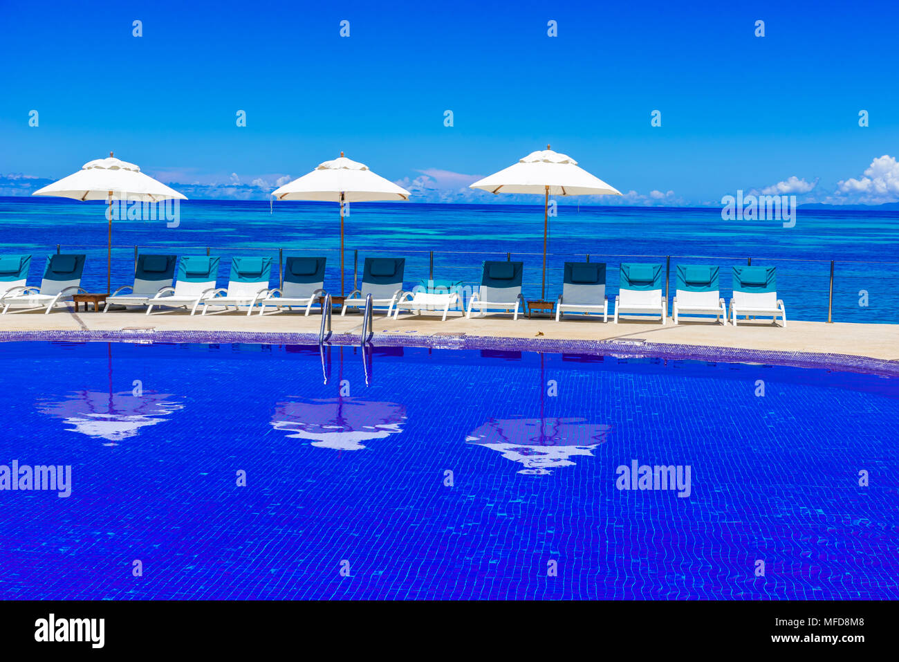 Sunbed on tropical beach - Stock Image