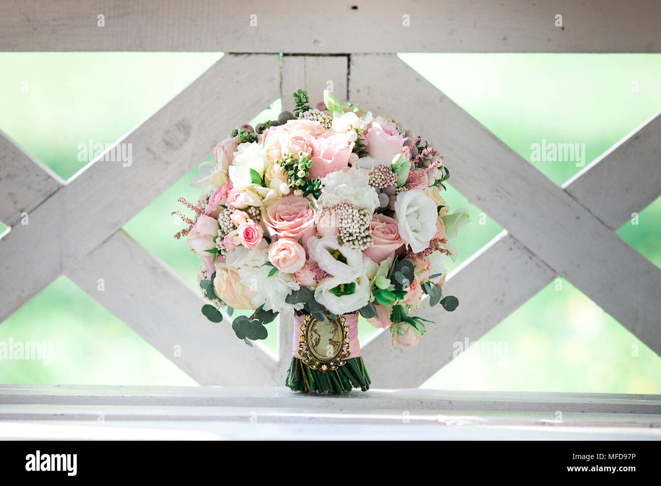 Wedding Bouquet On The Bench With White And Pink Flowers Stock Photo