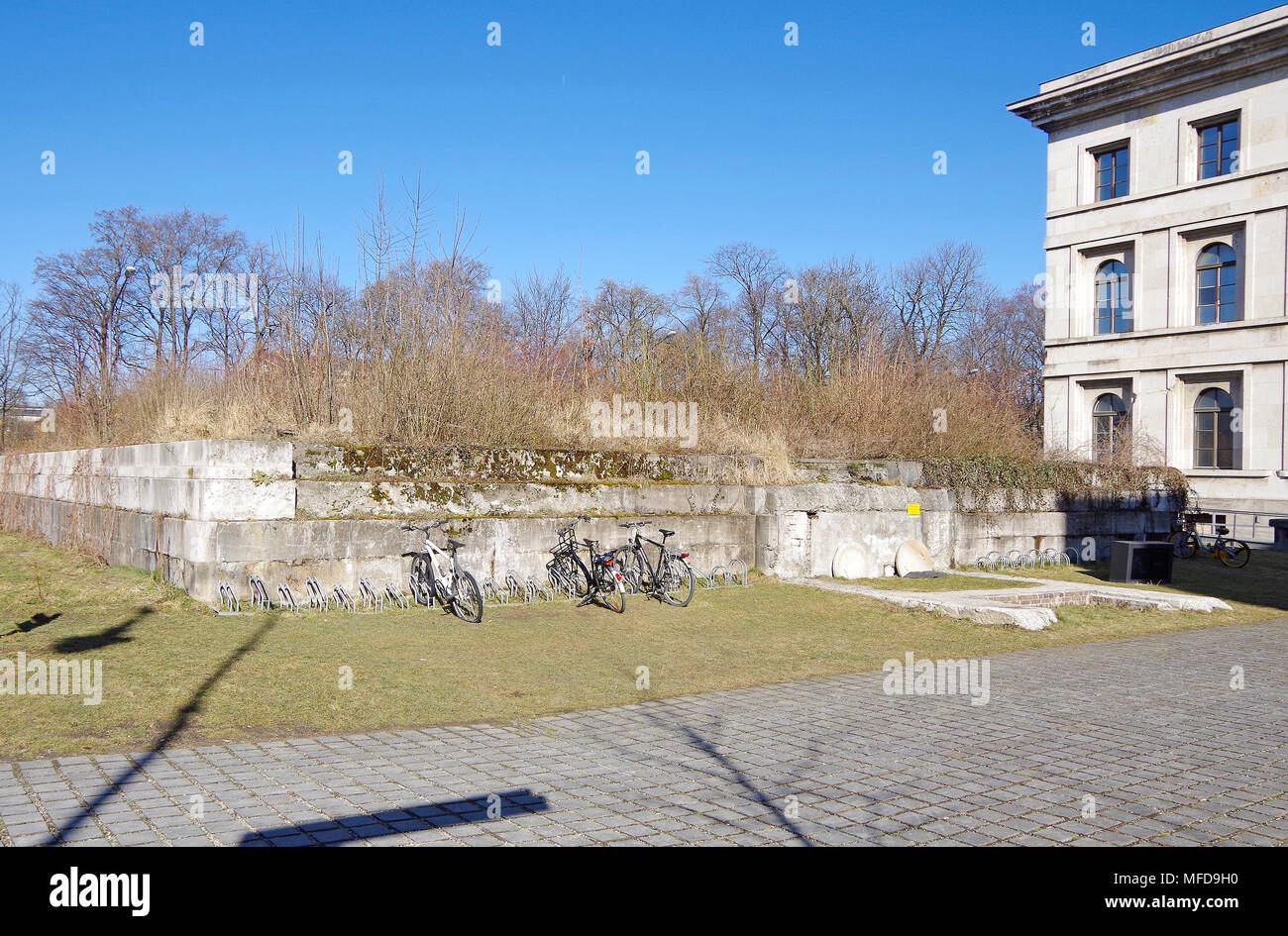 What appears to be the remains of a bunker which it was easier to bury than demolish beside the Fuhrerbau, Fuhrer's building, Munich, - Stock Image
