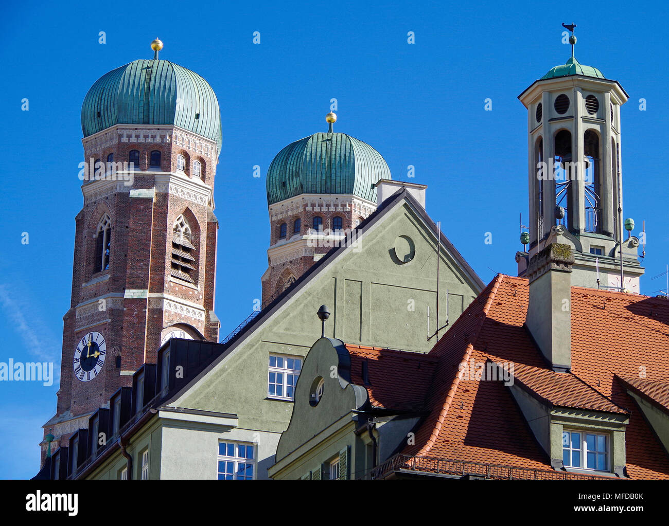 Munich, Bavaria, roofscape with twin domed towers of the Fraunkirche, a Belvedere, baroque gable, steep red- tiled roofs, &  attic windows - Stock Image