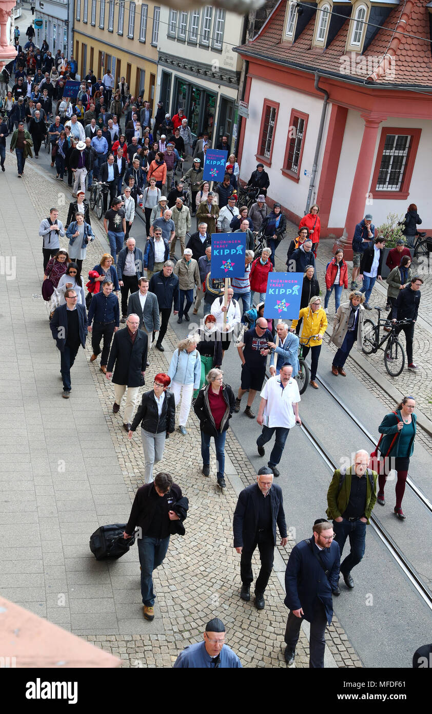 Erfurt, Germany. 25 April Germany, Germany, Erfurt: Participants in a demonstration ('Thuringia wears Kippa') wearing Kippas in the city centre of Erfurt. The demonstration in front of the new synagogue in Erfurt takes a stance against anti-Semitism and exclusion. Photo: Bodo Schackow/dpa-Zentralbild/dpa Credit: dpa picture alliance/Alamy Live News - Stock Image