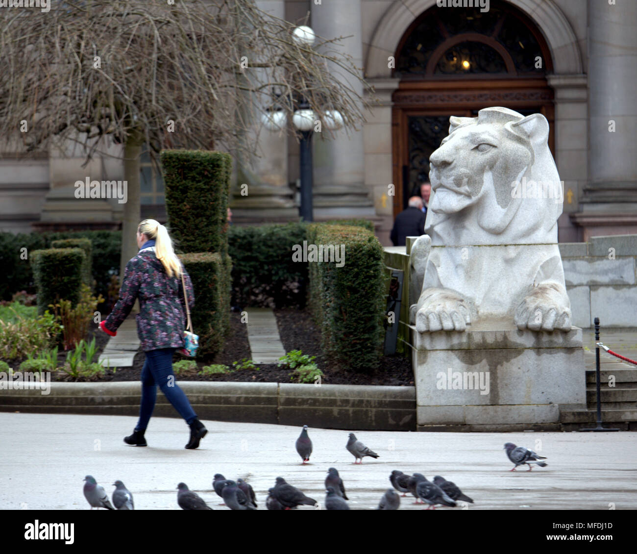 Glasgow, Scotland, UK 25th April. UK  young blonde girl walks in front of cenotaph  lion  and city chambers Weather:George Square locals and tourists inn  Sunshine and showers as the locals and tourists enjoy the beginning of summer. Gerard Ferry/Alamy news - Stock Image