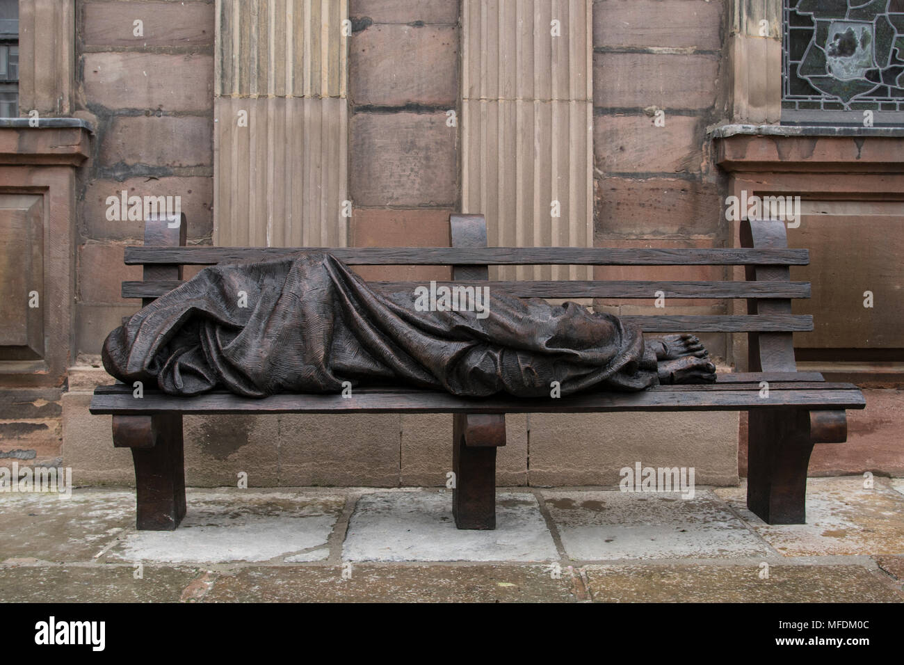 St. Annes Sq, Manchester, UK. 25th. April 2018: Homeless Jesus sculpture in St. Annes Square Manchester - a social comment on the homeless problem in the city. Homeless Jesus, also known as Jesus the Homeless, is the work of a Canadian sculptor and devout Catholic, Timothy Schmalz, whose original casting of Jesus on a park bench was installed in Toronto. Further casts have been made from the mould and have appeared in several cities around the world including the Papal Offices in Rome.. Credit: Dave Ellison/Alamy Live News Stock Photo