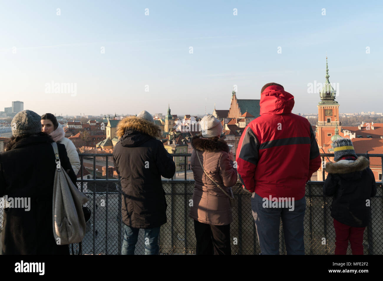 Warsaw, Poland - March 4 2018: Tourists enjoy the view over Warsaw old town from an observatory tower in Poland capital city. - Stock Image