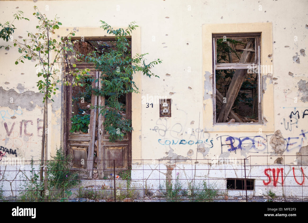 A bombed out building from the Bosnian War in Mostar, Bosnia and Herzegovina - Stock Image