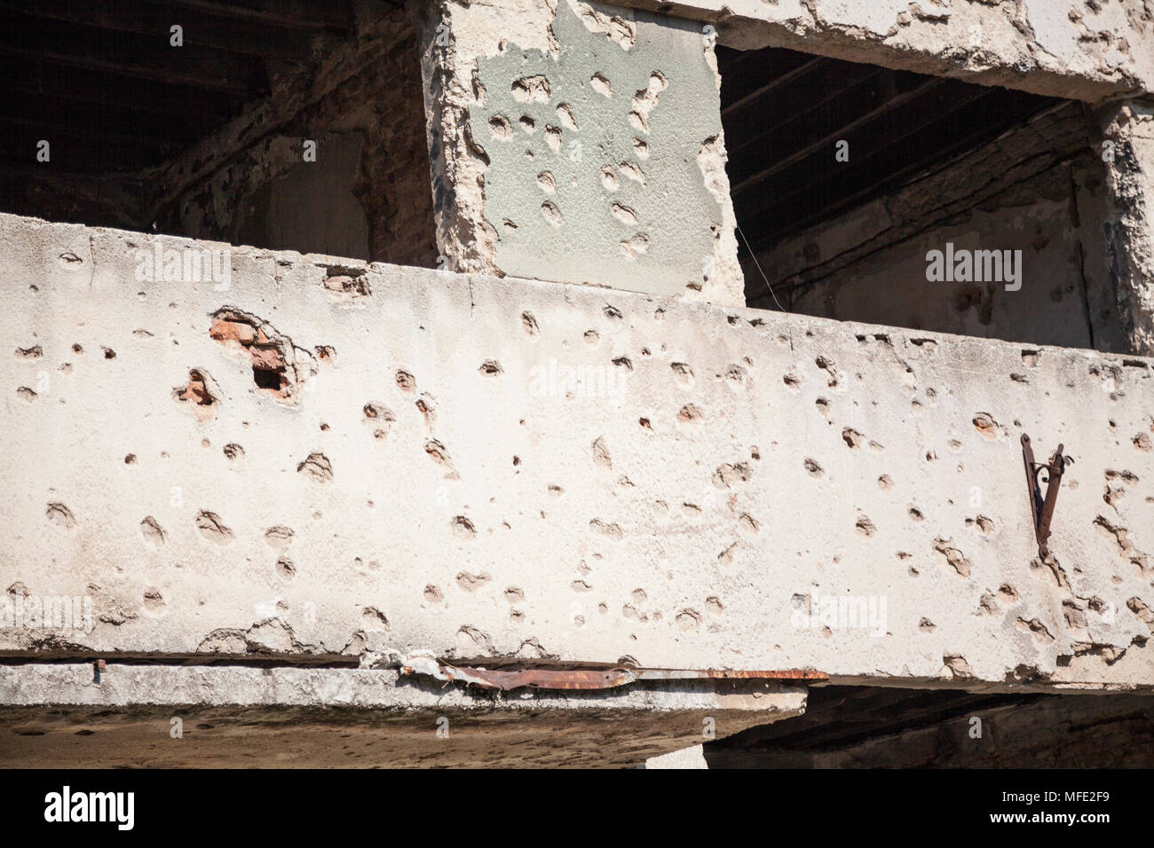 Close up of bullet damage on a wall from the Bosnian War in Mostar, Bosnia and Herzegovina - Stock Image