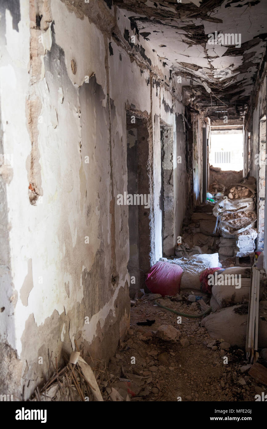 A corridor with sandbags in a bombed out building from the Bosnian War in Mostar, Bosnia and Herzegovina - Stock Image