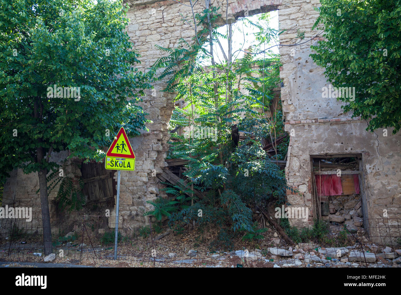 Trees growing within the remains of an old school from the Bosnian War in Mostar, Bosnia and Herzegovina - Stock Image