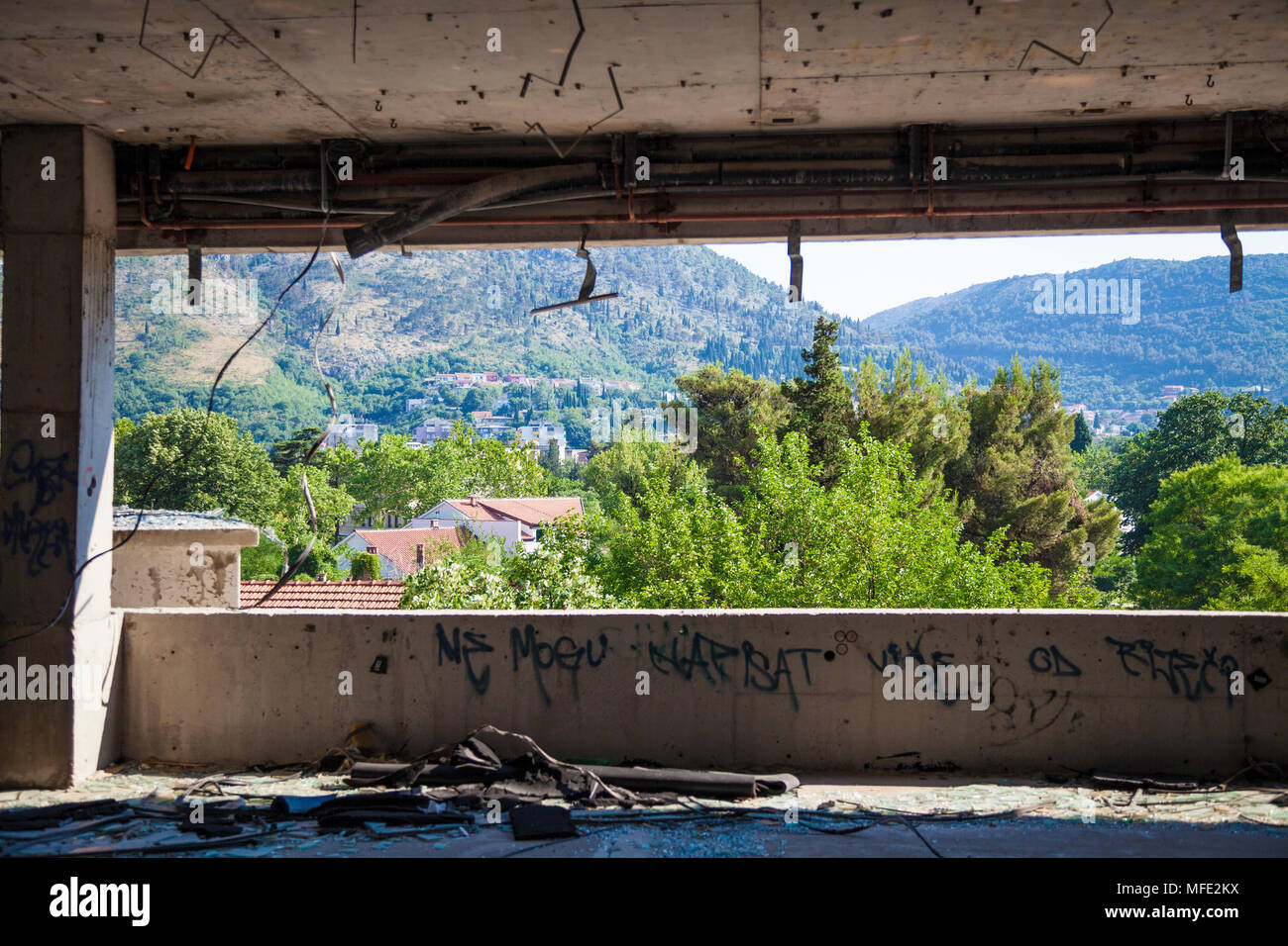 View of Mostar from a bombed out building from the Bosnian War in Mostar, Bosnia and Herzegovina - Stock Image
