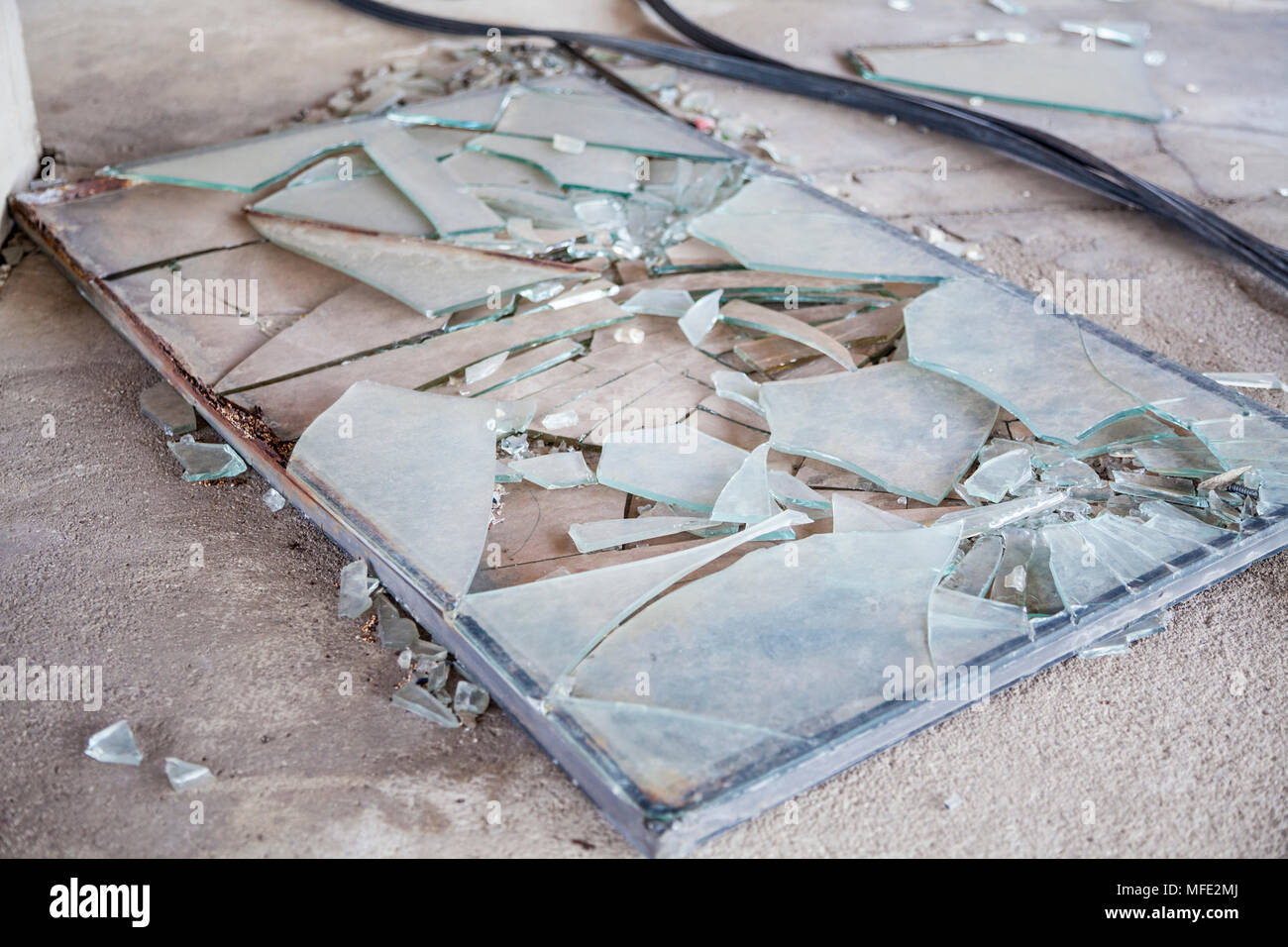 A smashed window inside a bombed out building from the Bosnian War in Mostar, Bosnia and Herzegovina - Stock Image
