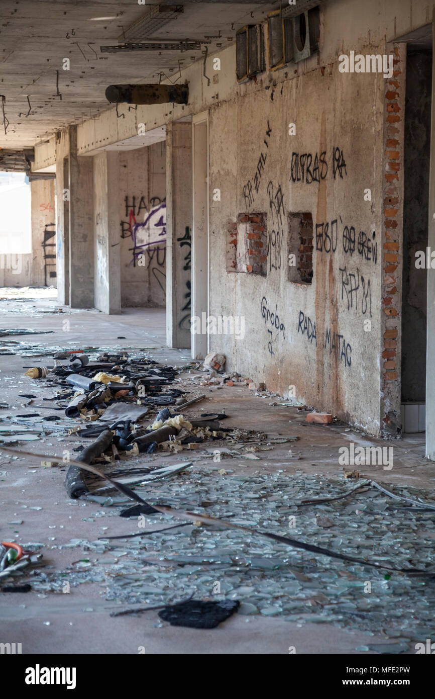 Broken glass inside a bombed out building from the Bosnian War in Mostar, Bosnia and Herzegovina - Stock Image