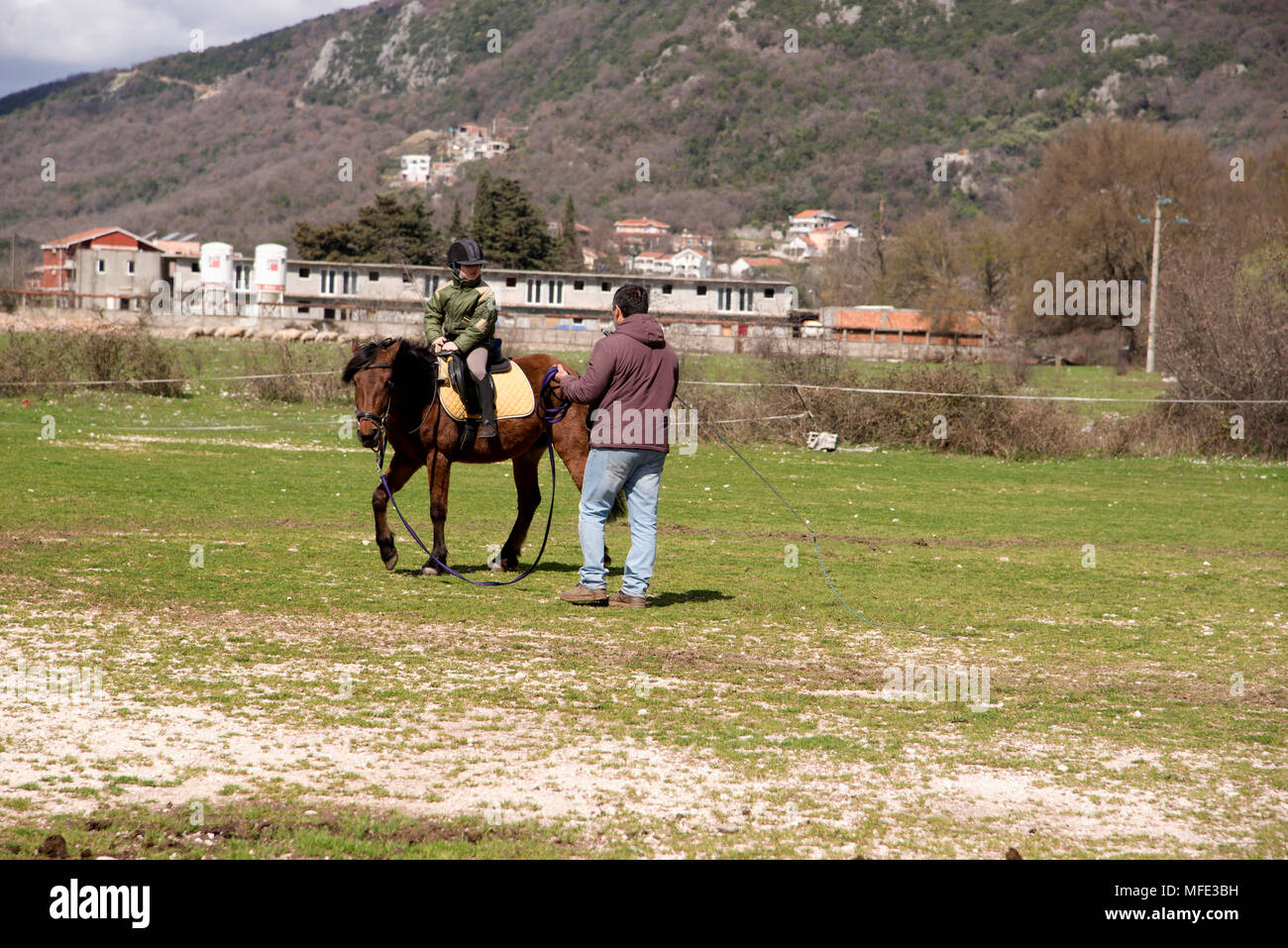 the first exercise on a horse . the boy meets equestrian sports in the equestrian club - Stock Image