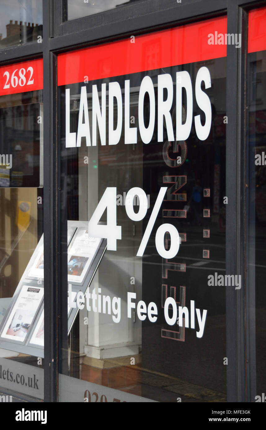 Landlords letting fee sign on an estate agent window. - Stock Image