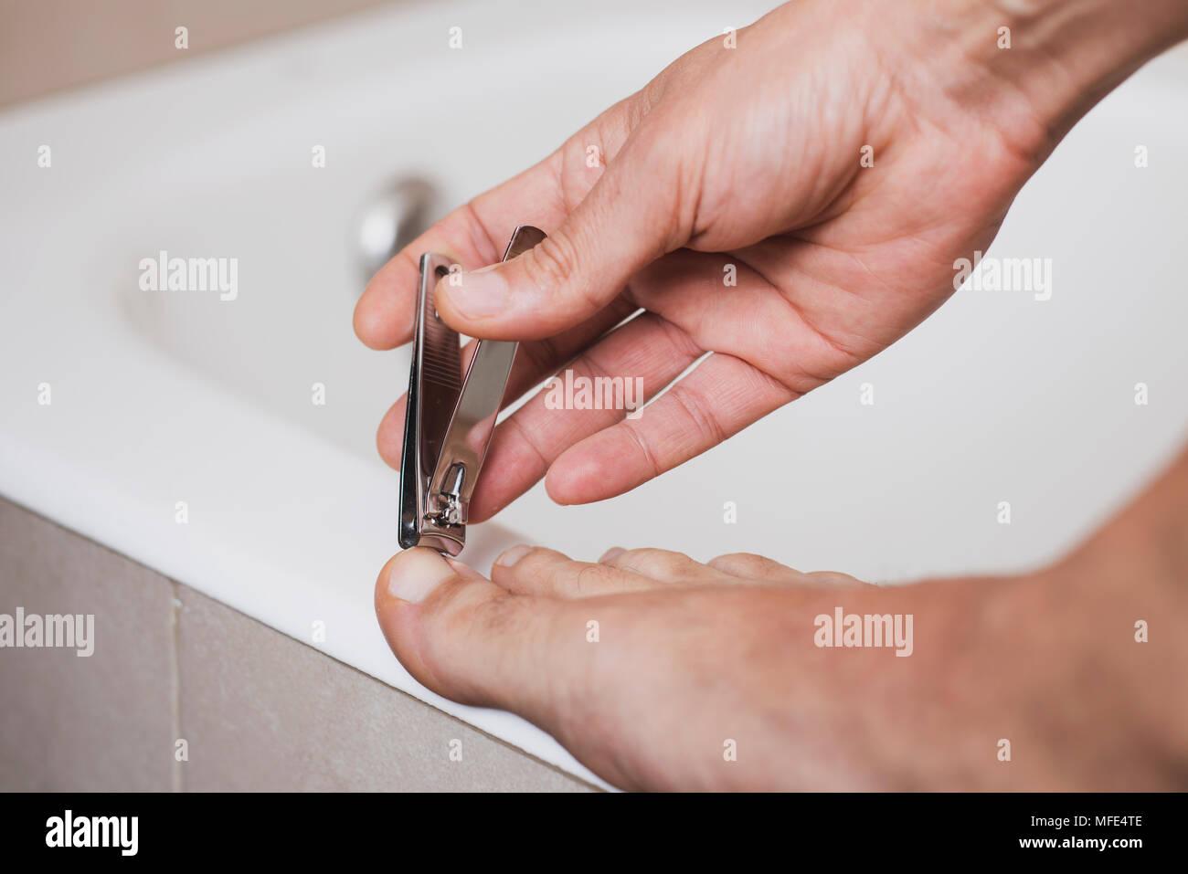 Cutting Toe Nails Stock Photos & Cutting Toe Nails Stock Images - Alamy
