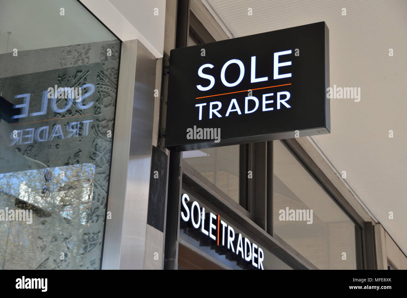 Sole Trader store sign in Oxford Street, London, UK. - Stock Image