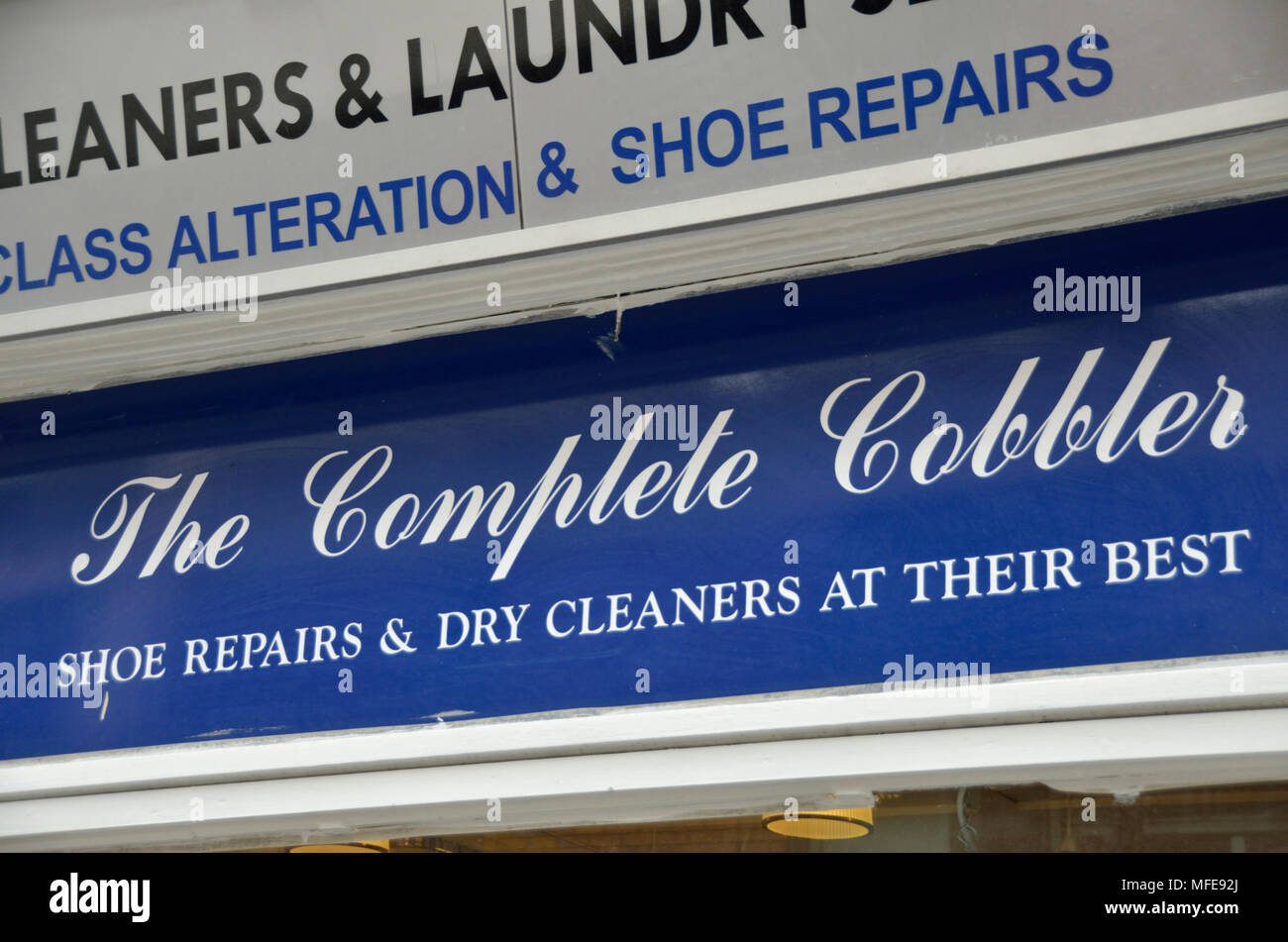 The Complete Cobbler shoe repairs sign. - Stock Image