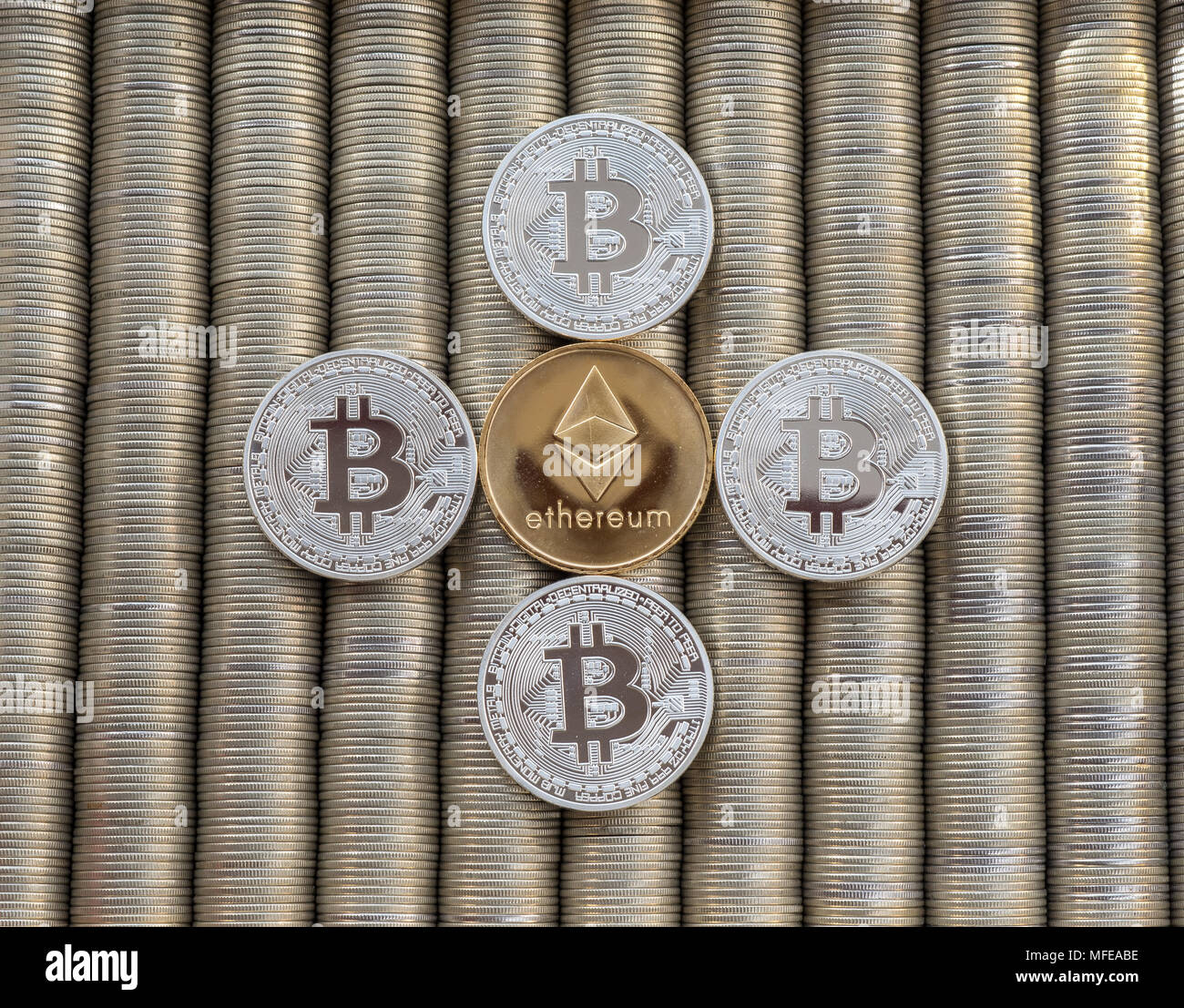 Silver Crypto coins bitcoin BTC Ethereum ETH. Metal coins are laid out in background to each other, close-up view from top, crypto currency exchange o - Stock Image