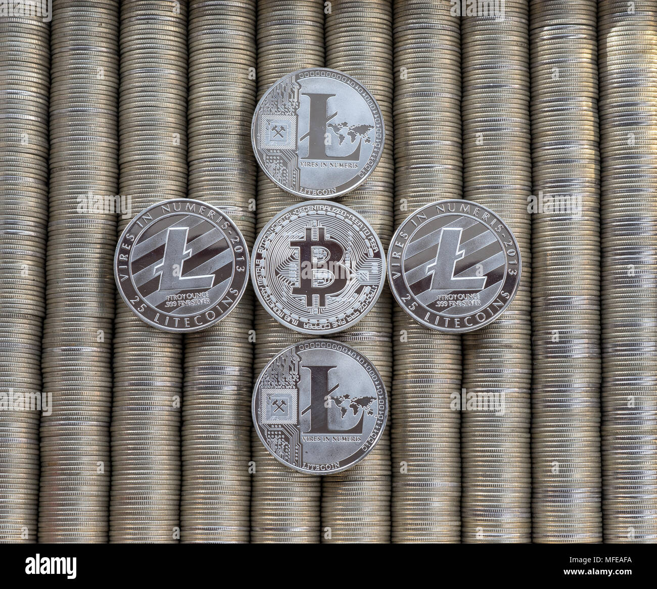Silver Crypto coins bitcoin BTC Litecoin LTC. Metal coins are laid out in a smooth background each other, close-up view from top, crypto currency exch - Stock Image