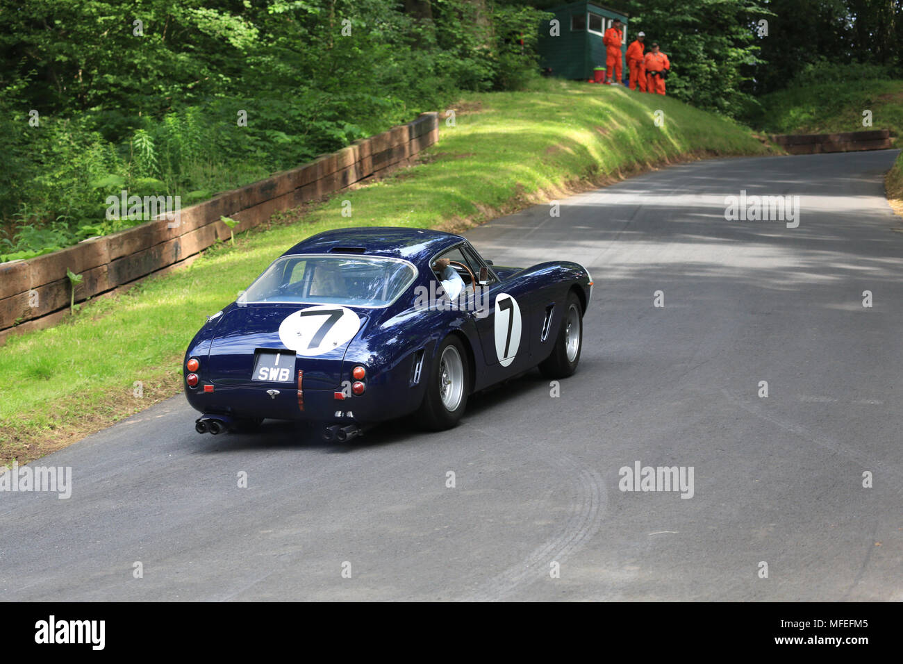 Sir Stirling Moss OBE driving a Ferrari 250 GT SWB up the hill at Shelsley Walsh hill climb, Worcestershire, uk. - Stock Image