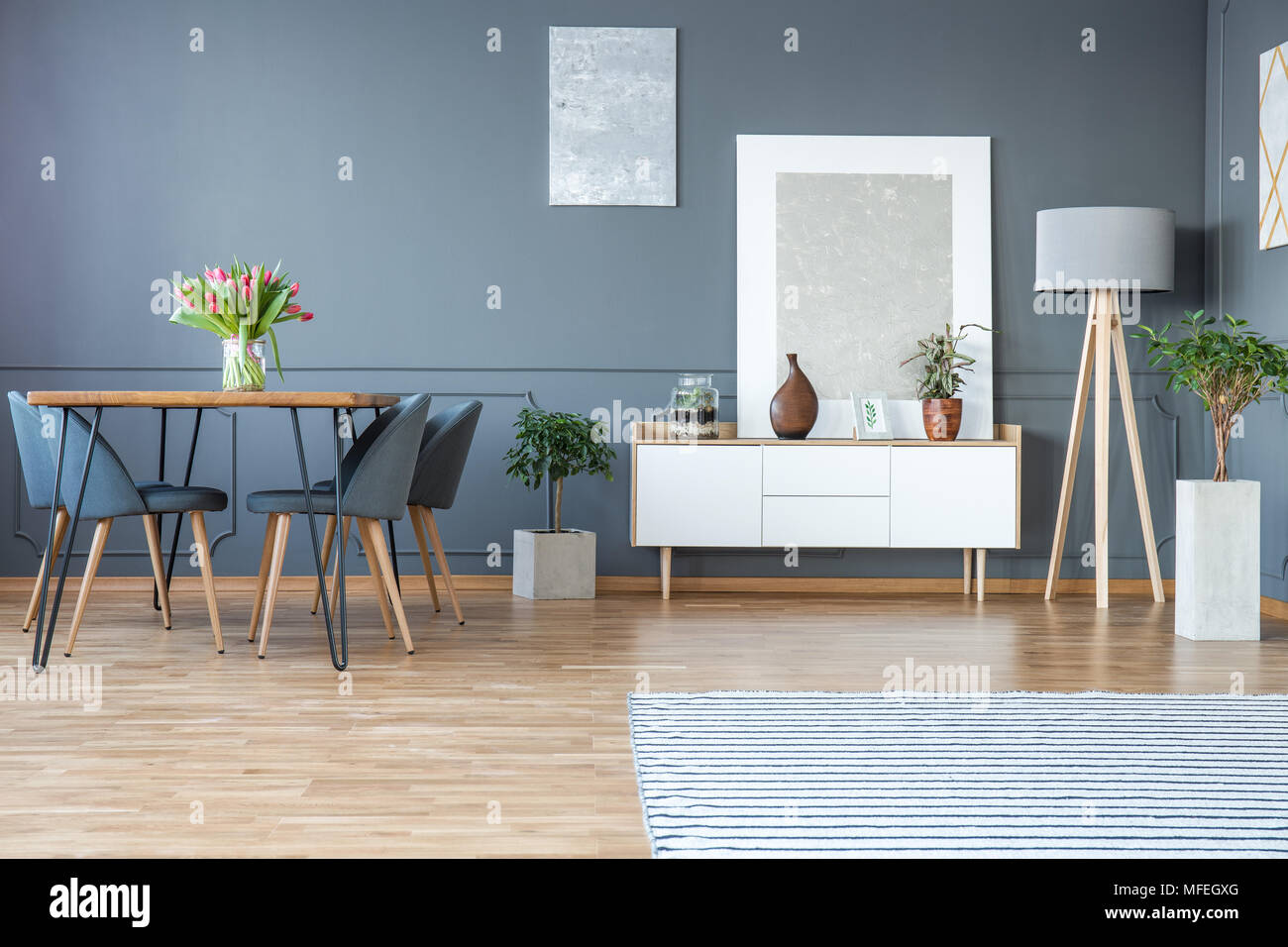 Red Tulips On Wooden Table In Grey Dining Room Interior With Silver - Painting cupboards grey