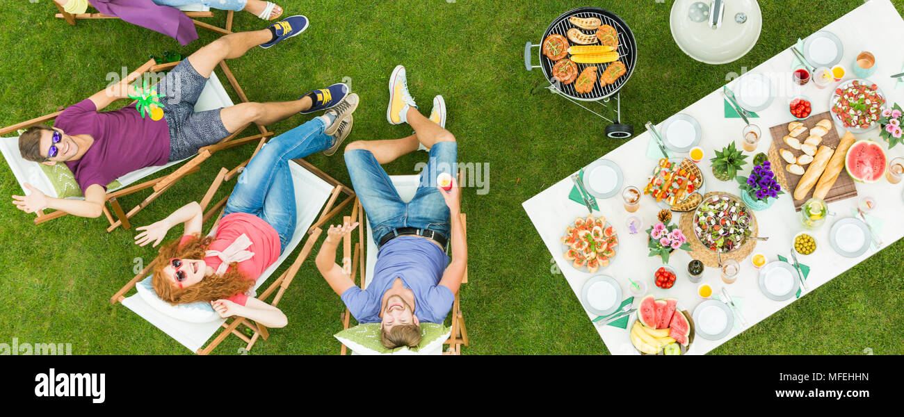 Friends taking drone selfie during barbecue party out of town - Stock Image