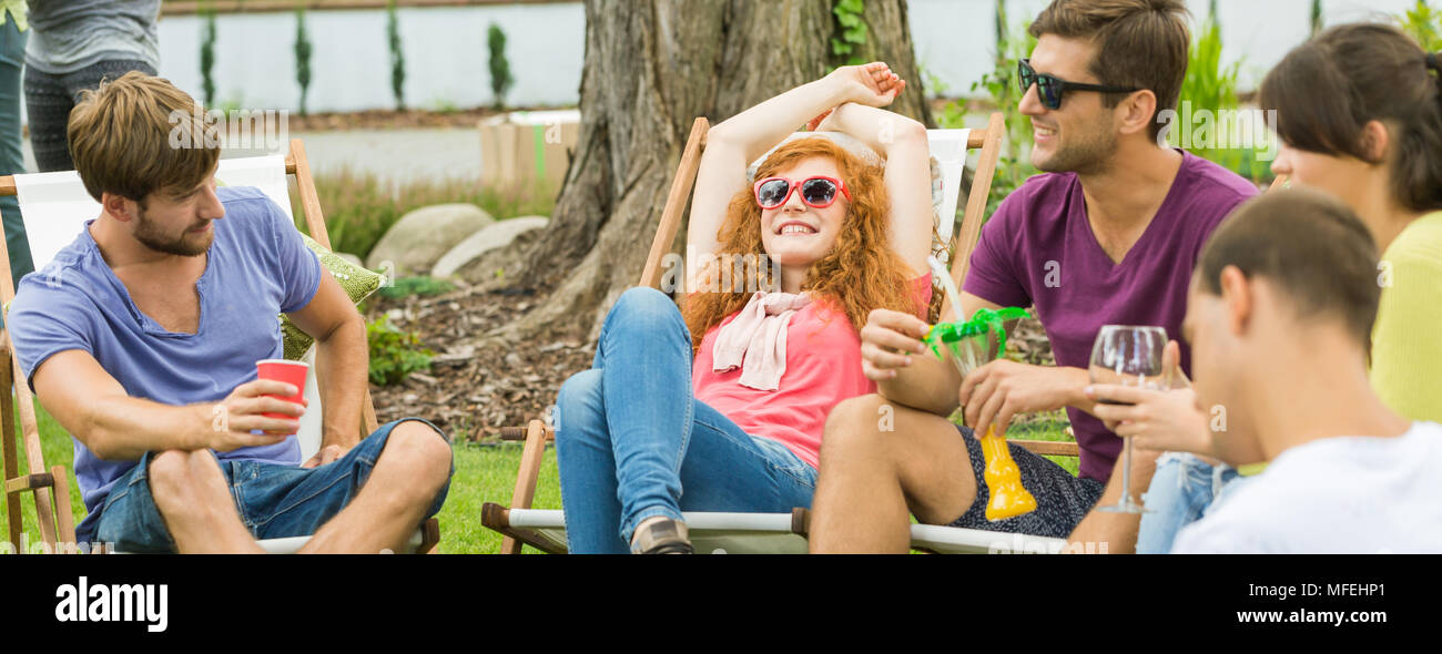 Young happy people chilling and having drinks in the countryside Stock Photo