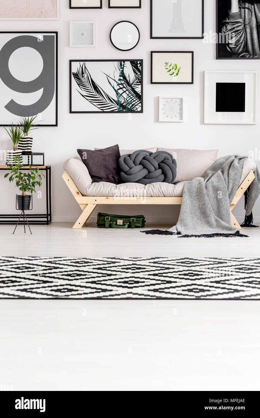 Patterned carpet in black and white living room interior with sofa ...